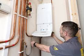 Plumbers Glasgow - Gas Safe Heating Engineer Repairing Boiler